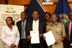 Vice-Chancellor DeKUT and Inspector General of Police during the signing of MoU